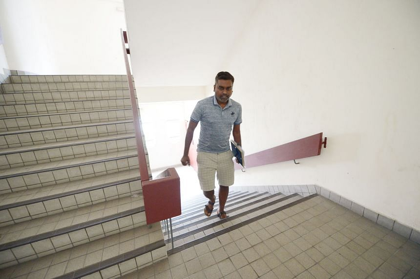 Mr Jai Prakash, 38, who runs Jai's Security Services, taking the stairs to his office on the 13th floor of Golden Mile Tower yesterday.