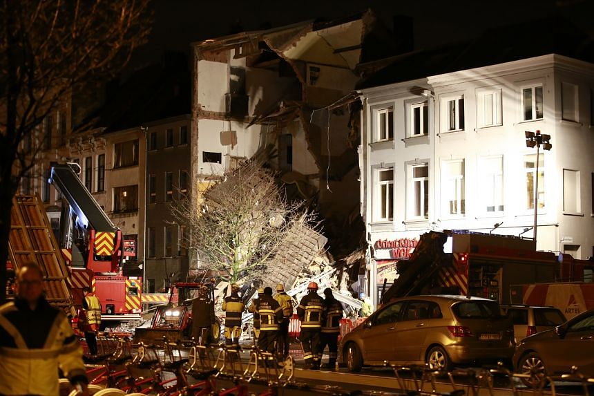 Firefighters at the Paardenmarkt area of the port city of Antwerp where the blast occurred late on Monday. Apart from the two dead, 14 others were injured in the explosion, six of them seriously. Several people were pulled alive from the rubble after