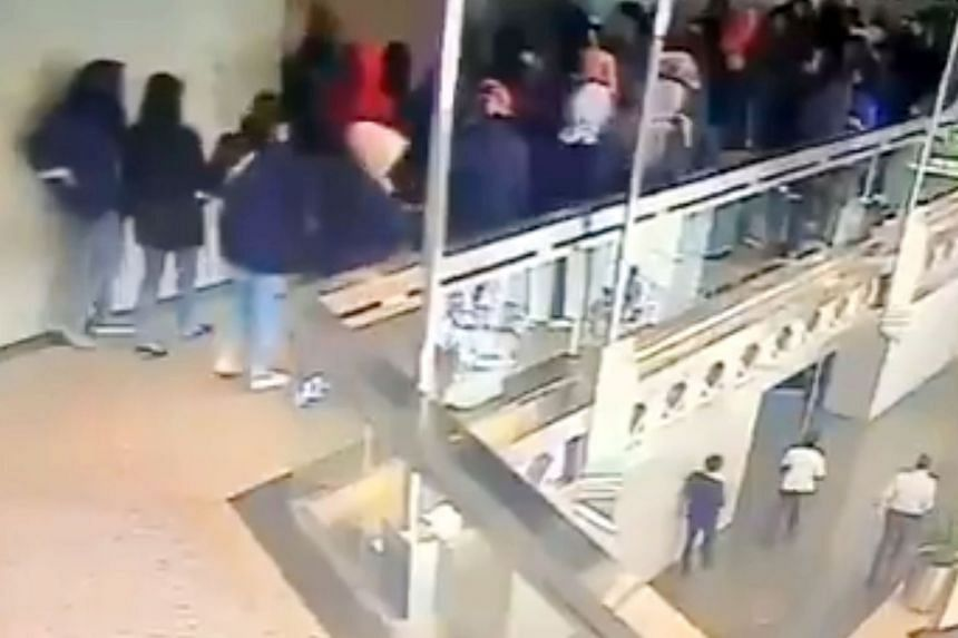 Closed-circuit television footage showing the students walking along the mezzanine-floor walkway of the IDX building in Jakarta on Monday when it gave way, sending them falling one floor down.