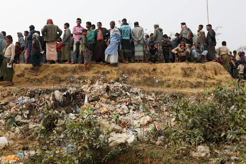 Rohingya refugees lining up for daily essentials at Balukhali camp, near Cox's Bazar, Bangladesh, on Jan 15.
