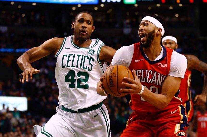 New Orleans Pelicans forward Anthony Davis (right) driving against Boston Celtics forward Al Horford, during their NBA game on Jan 17, 2018.