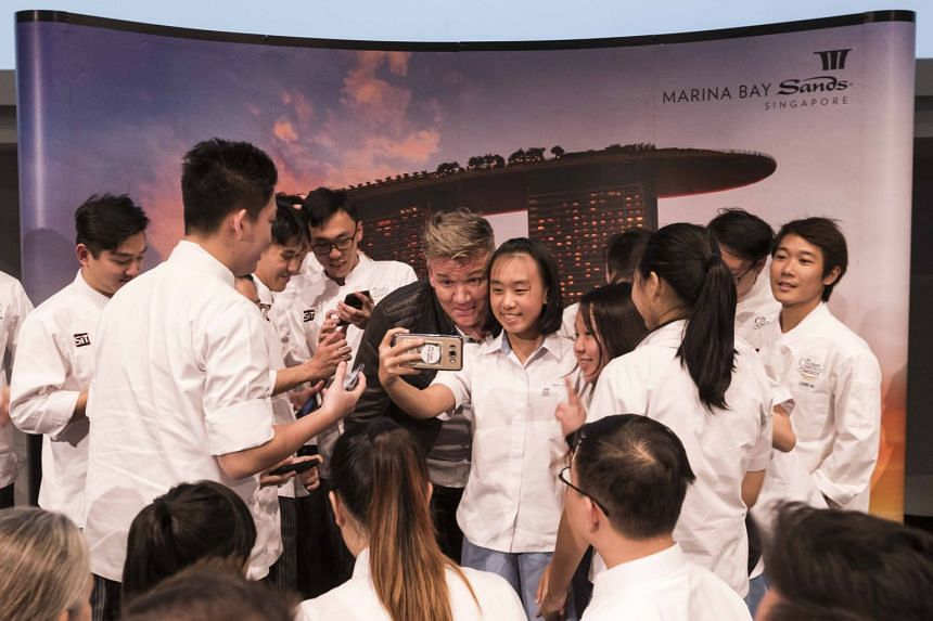 Chef Gordon Ramsay take photos with the participants of an In Conversation With session hosted by Marina Bay Sands at the ArtScience Museum, on Jan 16, 2017.