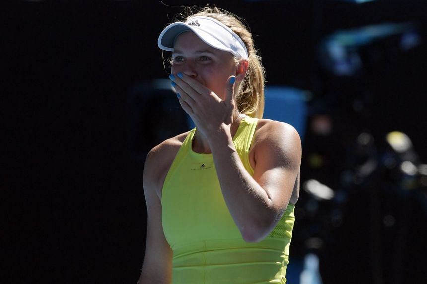 Caroline Wozniacki (pictured) of Denmark celebrates her win against Jana Fett of Croatia during the second round on day three of the Australian Open tennis tournament in Melbourne on Jan 17, 2018.