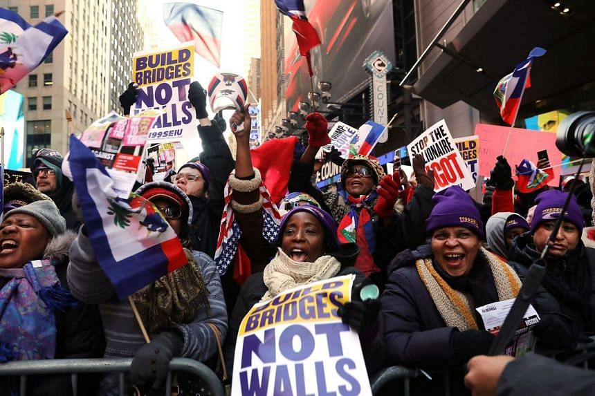 Hundreds of people, many of them Haitians, demonstrate against racism in Times Square, New York, on Martin Luther King Day on Jan 15.