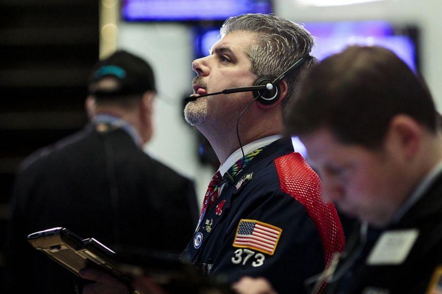 Traders work on the floor of the New York Stock Exchange, Jan 16, 2018.