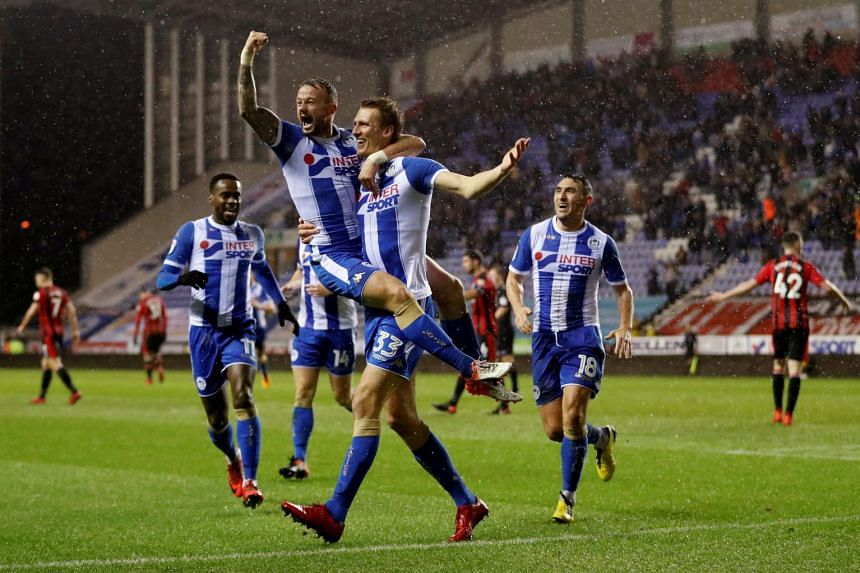 Wigan Athletic's Dan Burn celebrates scoring their second goal with Noel Hunt and team mates.