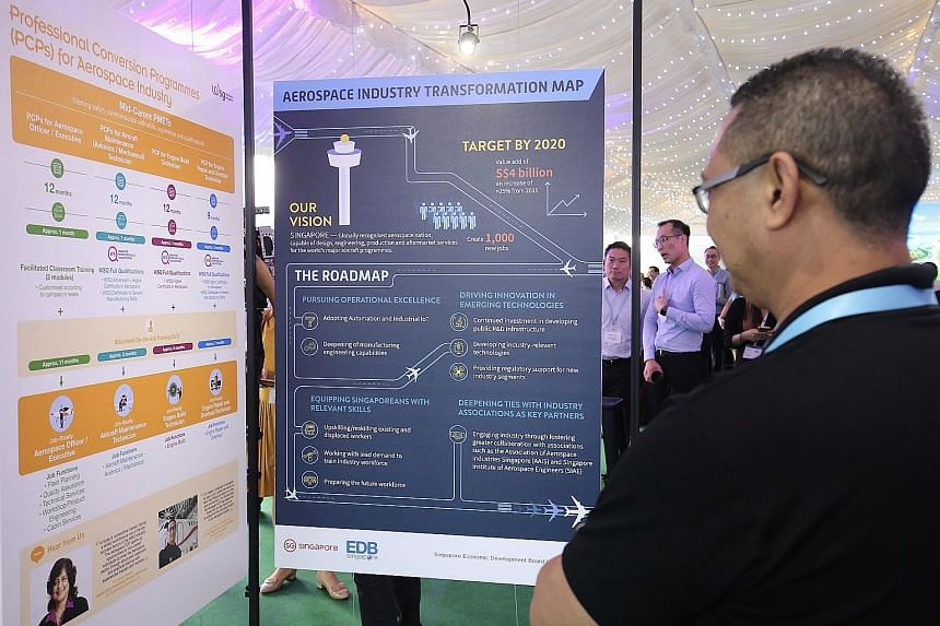Minister for Trade and Industry (Industry) S. Iswaran (top) with Ngee Ann Polytechnic students who contributed ideas and concepts for the upcoming Biodiversity Park at Seletar Aerospace Park. (Above) Details about the aerospace industry transformatio