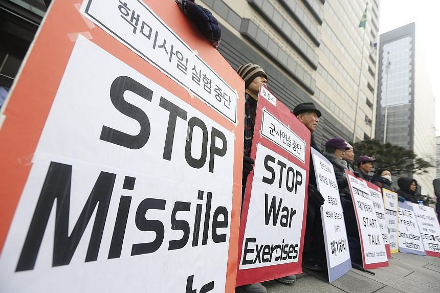 South Koreans rallying against US policy towards North Korea near the US Embassy in Seoul on Tuesday. They demanded peace talks between the US and North Korea, ahead of the latter's participation in the Winter Olympics.