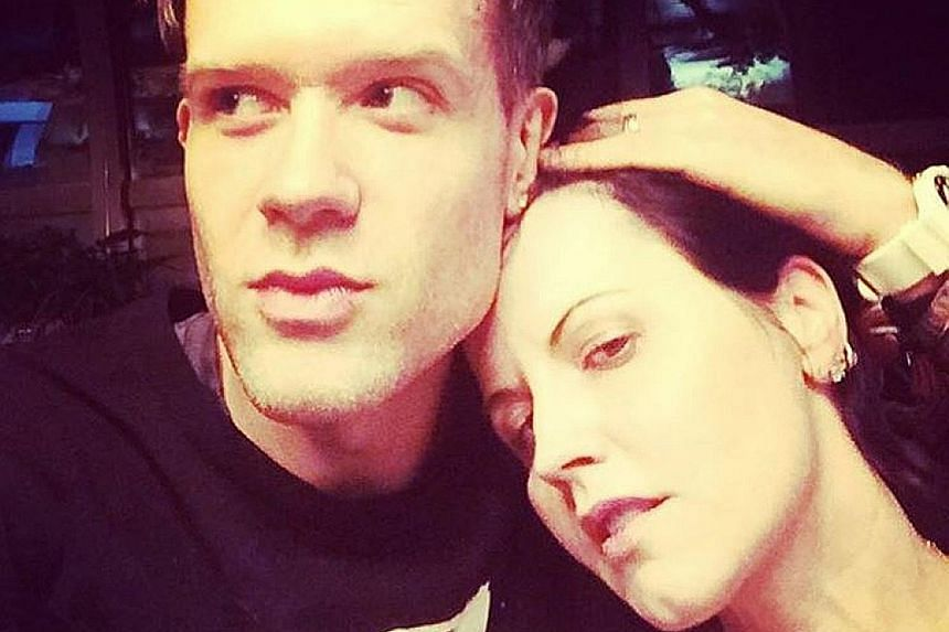 The Cranberries frontman Dolores O'Riordan in a New Year's Eve photo with her partner, New York-based musician Ole Koretsky.