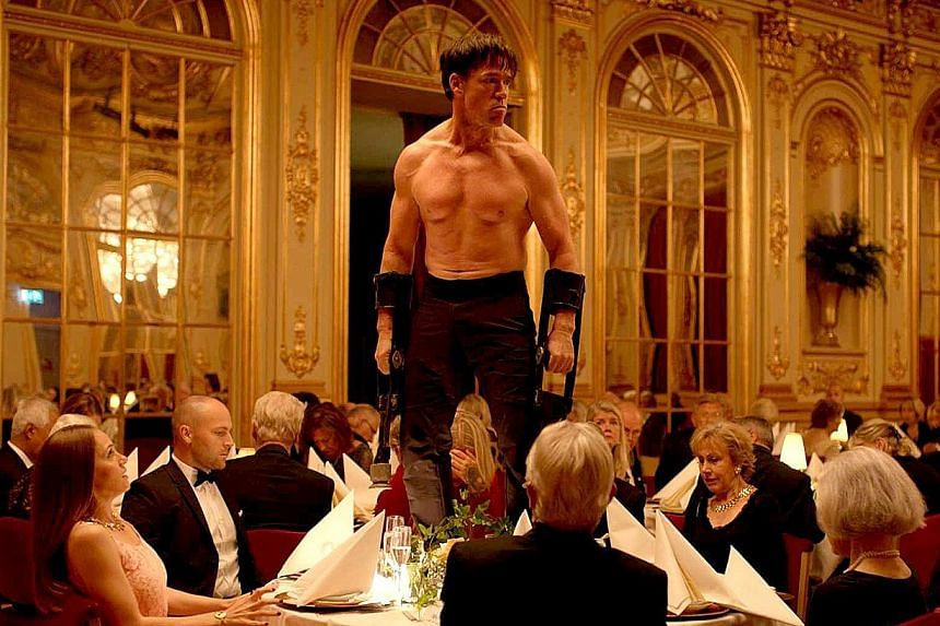Terry Notary in a jungle predator scene at a formal dinner in The Square.