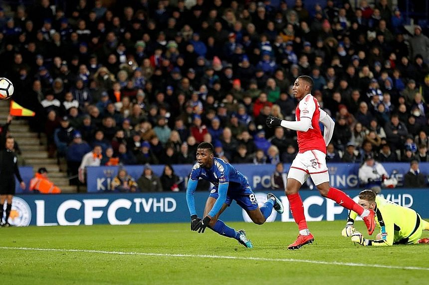 Leicester City striker Kelechi Iheanacho (left) scoring in the FA Cup third-round replay at home to Fleetwood Town. The goal, the Premier League side's second in Tuesday's 2-0 victory, was initially disallowed for offside, before referee Jon Moss cha