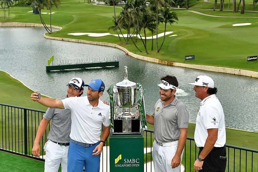 From left: Ryo Ishikawa, Sergio Garcia, Louis Oosthuizen and Pat Perez pose for a wefie with the SMBC Singapore Open trophy at Sentosa Golf Club.