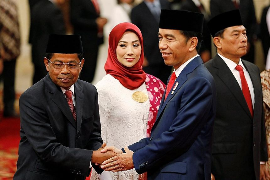 President Joko Widodo greeting the new Social Affairs Minister Idrus Marham (far left) at the swearing-in ceremony at the presidential palace in Jakarta yesterday. With them are Mr Idrus' wife Ridho Ekasari and Presidential Chief of Staff Moeldoko.