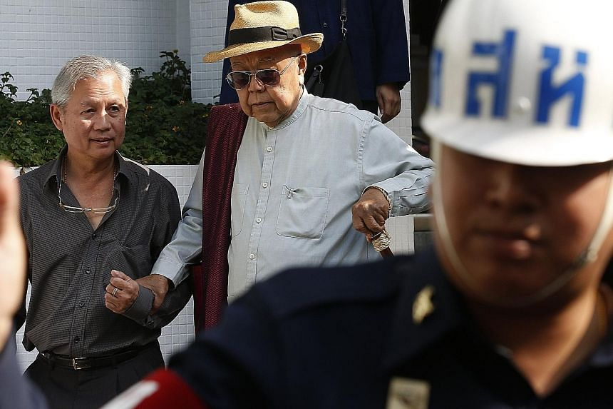 Thai academic Sulak Sivaraksa (with hat) leaving the Martial Court in Bangkok yesterday after the court dropped charges of lese majeste against him. He thanked Thailand's current monarch, King Maha Vajiralongkorn, saying he had appealed to the ruler