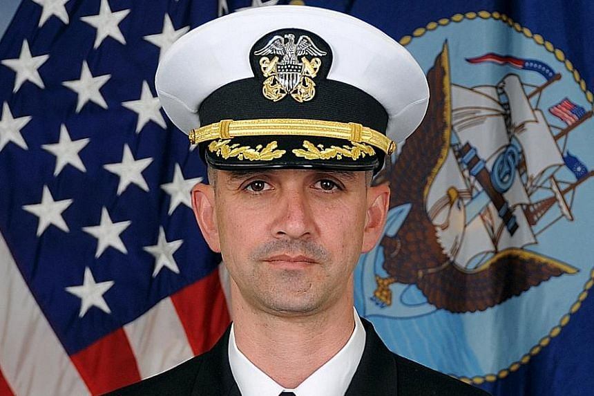 The damage caused to the USS John S. McCain led to the deaths of 10 sailors in August. The destroyer's Commander Alfredo Sanchez (above) faces charges including negligent homicide.
