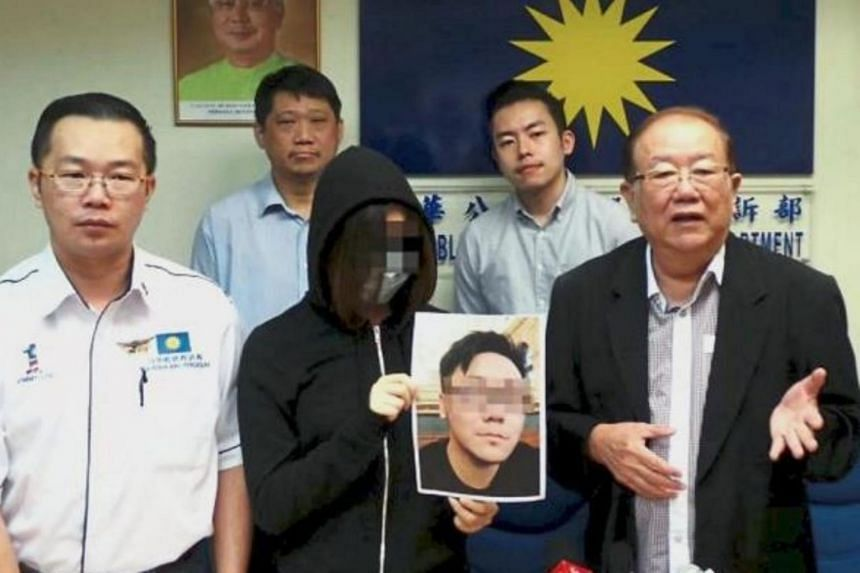 Datuk Seri Michael Chong speaking to the press while Amy holds a photograph of the man who allegedly promised her jobs with sugar daddies. Looking on is Perak MCA Public Services and Complaints Bureau chief Jimmy Loh (left).