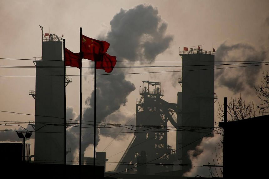 Chinese national flags flying near a steel factory in Wu'an, Hebei province, China.