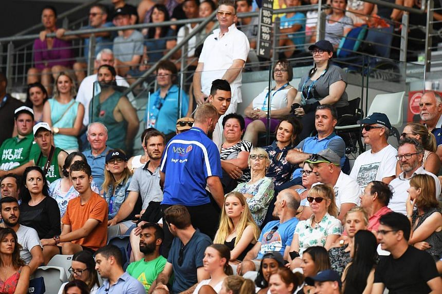 A spectator is escorted out of the Hisense Arena after yelling during the men's second round match between Nick Kyrgios and Viktor Troicki at the Australian Open Grand Slam tennis tournament in Melbourne, on Jan 17, 2018.