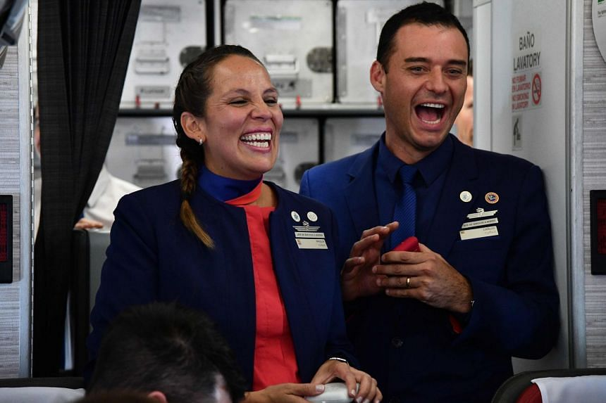 Crew members Paula Podest and Carlos Ciufffardi smile after being married by Pope Francis.