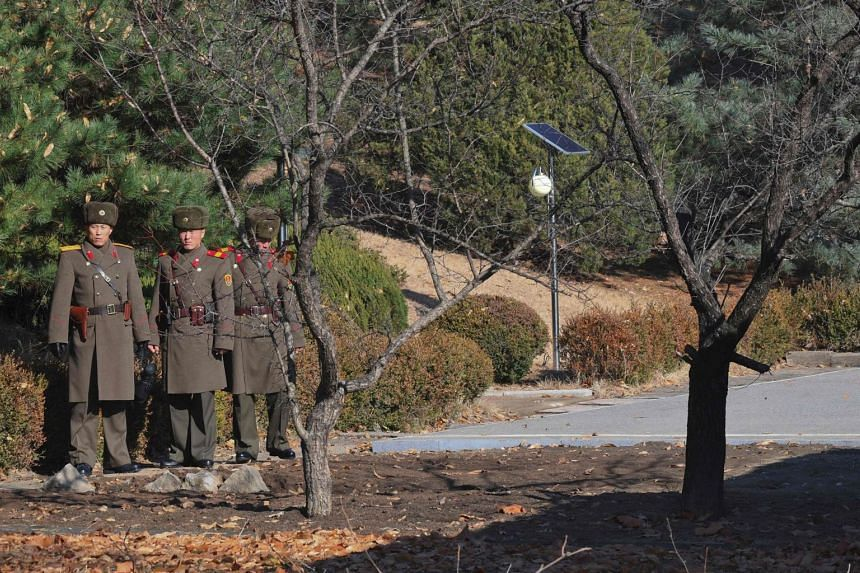 North Korean soldiers staring across to the southern side at the truce village of Panmunjom on Nov 27, 2017.