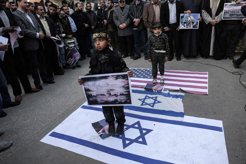 Palestinian supporters of the Islamic Jihad movement protest against the US president's decision to recognise Jerusalem as the capital of Israel, in Rafah, Palestine, on Jan 12, 2018.