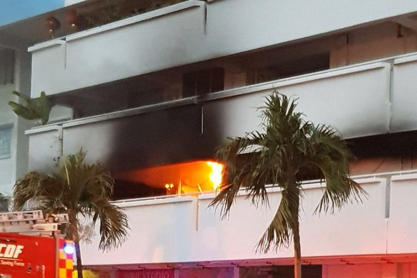 Flames coming out of a second-floor unit at Block 147 Serangoon North Ave 1 on Jan 18.