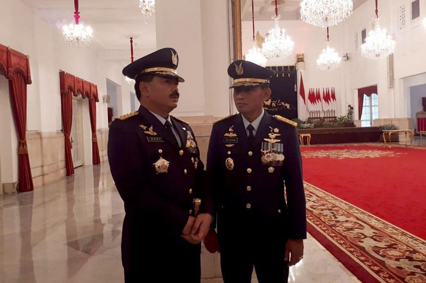 Air Force chief of staff Air Marshall Yuyu Sutisna (right) speaks with Indonesian Military commander Marshall Hadi Tjahjanto after the inauguration ceremony at the State Palace in Jakarta on Jan 17, 2018.