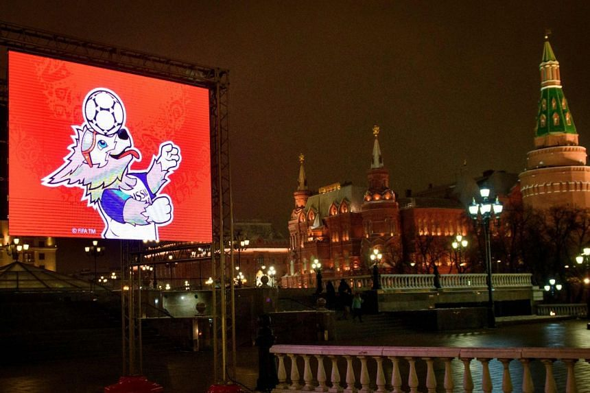 A video screen shows the FIFA World Cup 2018 mascot Zabivaka on the Manezhnaya square outside the Kremlin in Moscow on Jan 14, 2018.