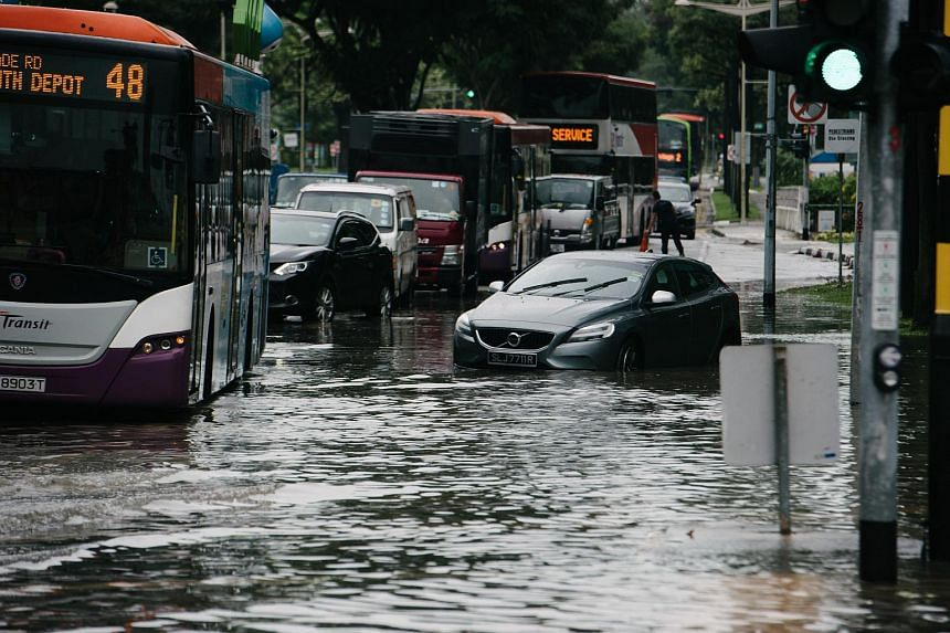 Heavy rains in Singapore caused flooding at junction of Upper Changi and Bedok North Ave 4 on Jan 8, 2018.