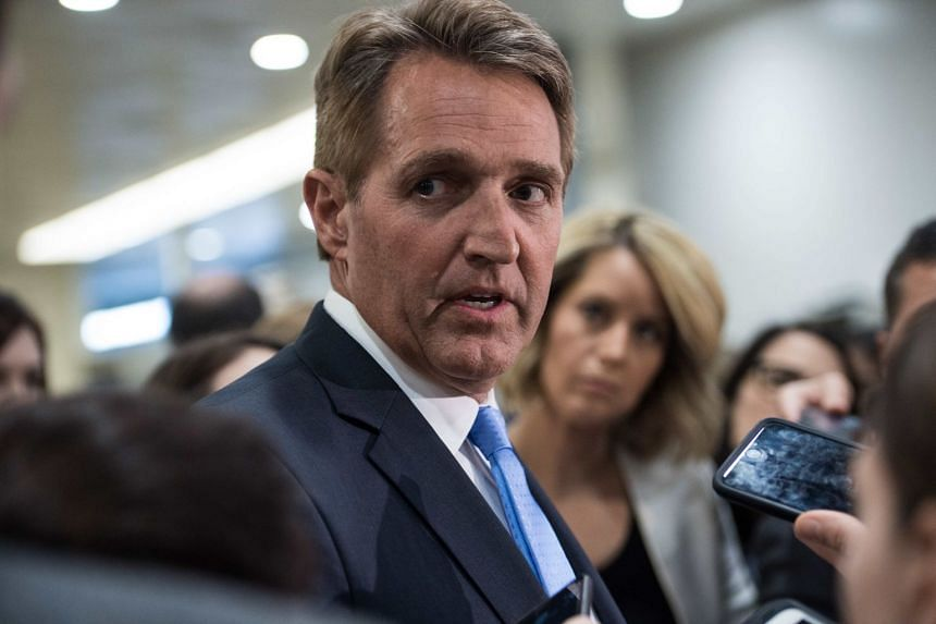 """Republican US Senator Jeff Flake (pictured) said Donald Trump's portrayal of the press as """"the enemy of the people"""" and repeated White House references to """"fake news"""" and""""alternative facts"""" had spurred copycats. Now"""
