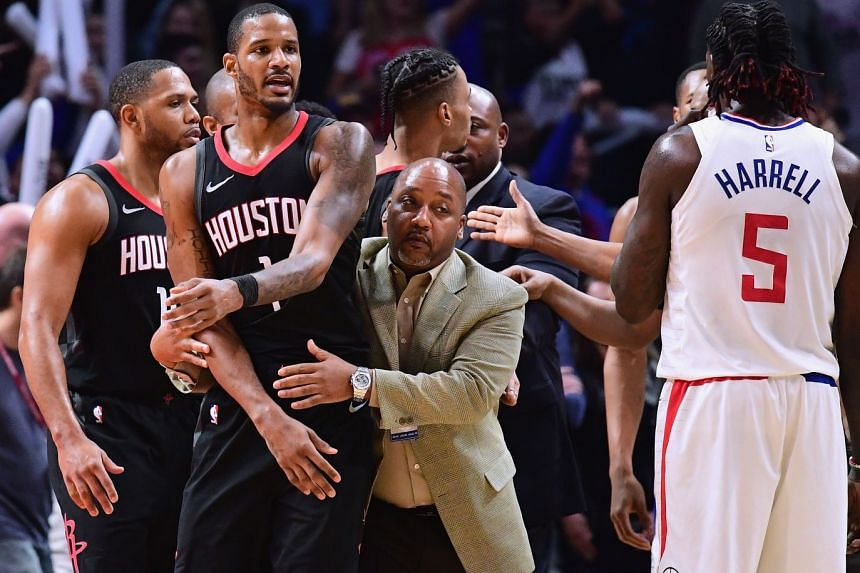 Trevor Ariza of the Houston Rockets is restrained by an assistant coach before his ejection from the game during an LA Clippers win at the Staples Center on Jan 15, 2018.