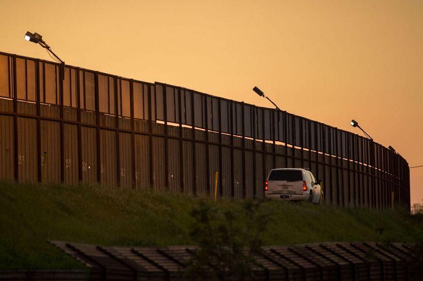 A border patrol agent driving along the US-Mexico border crossing in San Ysidro, California, on Jan 26, 2017.