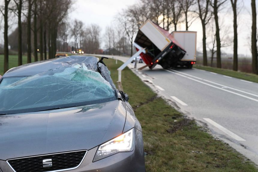 A lorry and a damaged car following the strong winds in Kampen, The Netherlands, on Jan 18.