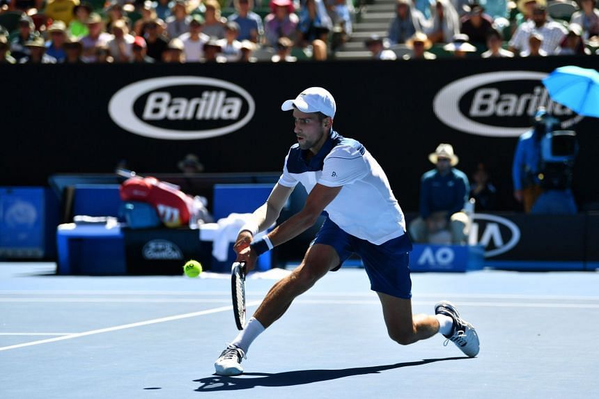 Serbia's Novak Djokovic hits a return against France's Gael Monfils during their men's singles second round match on day four of the Australian Open tennis tournament in Melbourne on Jan 18, 2018.