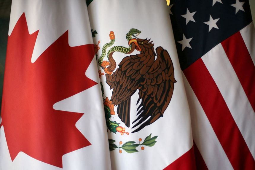 Flags are pictured during the fifth round of Nafta talks involving the US, Mexico and Canada, Nov 19, 2017.