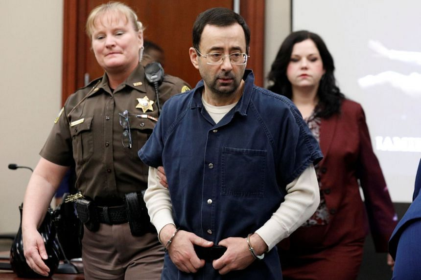 Larry Nassar is escorted into the courtroom during his sentencing hearing in Lansing, Michigan.