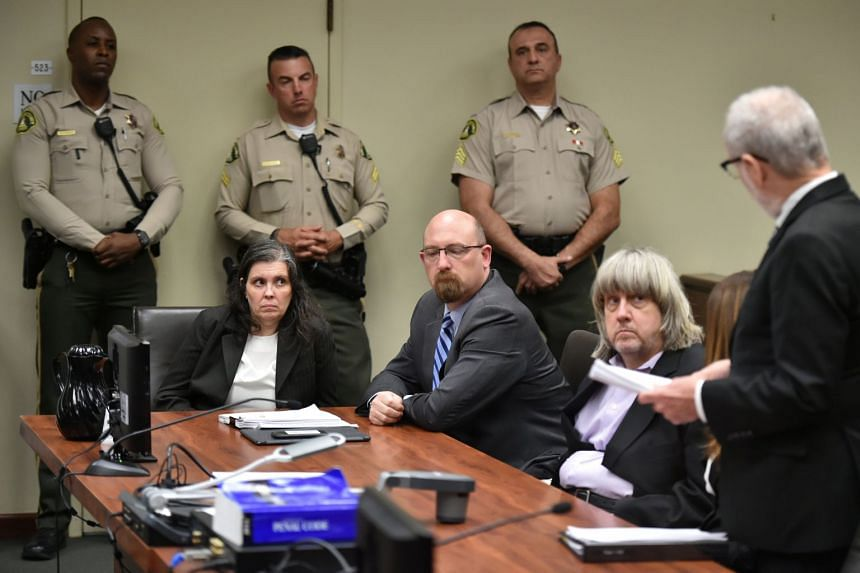 David Turpin (second, right) and Louise Turpin (second, left) appear in court for their arraignment in Riverside, California, on Jan 18, 2018.