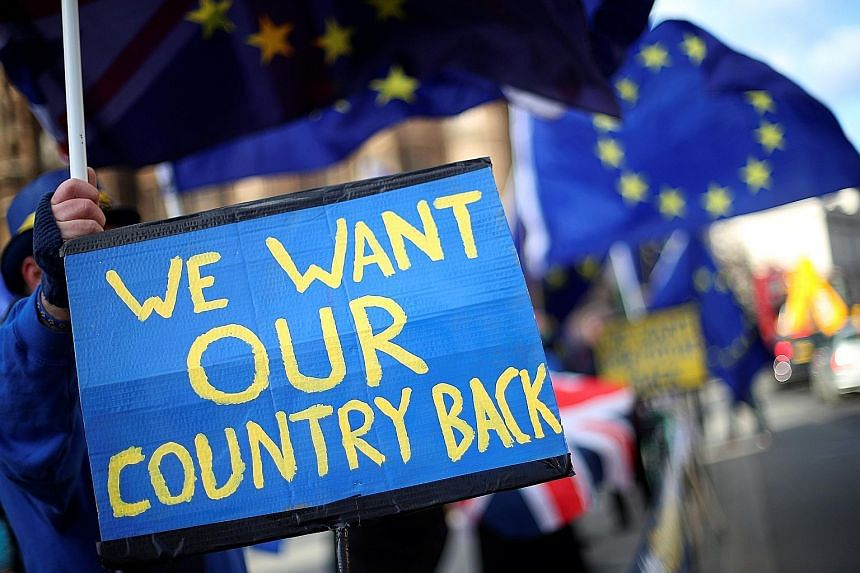 Anti-Brexit protesters near the Houses of Parliament in London on Tuesday.