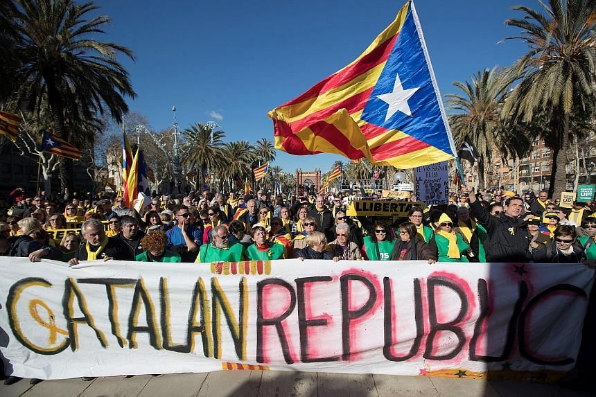 People gathering in Barcelona on Wednesday to watch a session of the new Parliament formed after the Dec 21 regional election that was called by the Spanish Government.