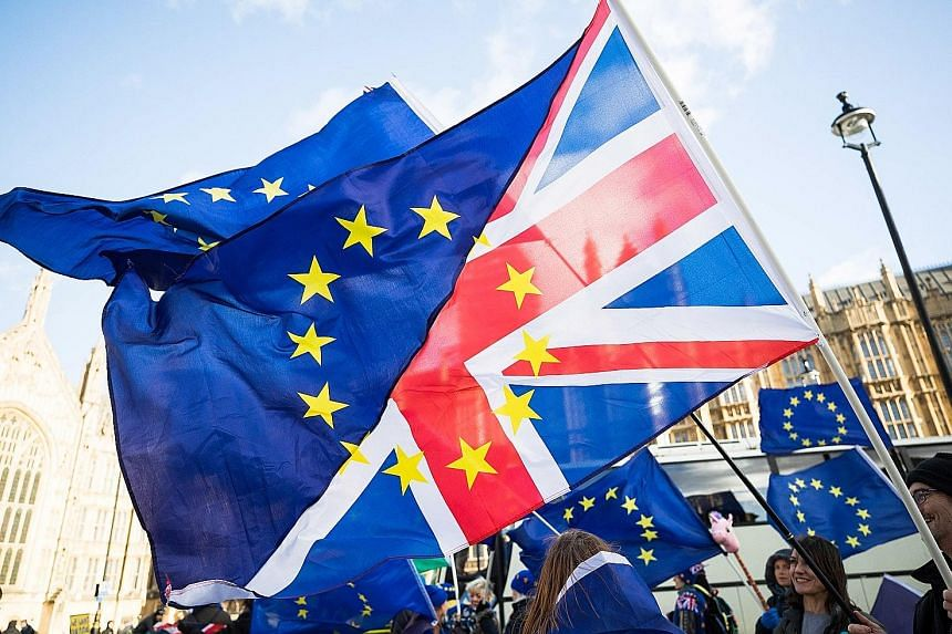 """Pro-Europe protesters wave flags made up of European Union and British flags outside the Houses of Parliament in London on Tuesday. Facebook plans to launch a """"detailed analysis of historical data"""" to establish whether there was Russian interference"""