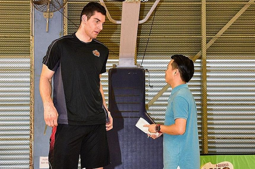 The 26-year-old Samuel Deguara, at 2.25m the tallest man in Malta, speaking to reporter David Lee. Mono Vampire coach Douglas Marty says Deguara brings a large presence at both ends of the court.