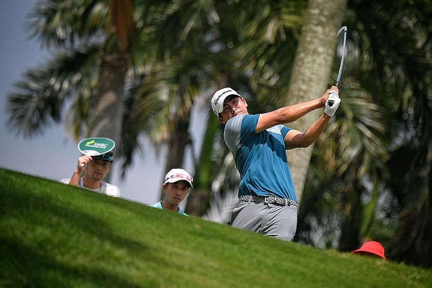 Kurt Kitayama teeing off during the first round of the SMBC Singapore Open at Sentosa Golf Club's Serapong Course yesterday. The American was flawless on the back nine, making four birdies.