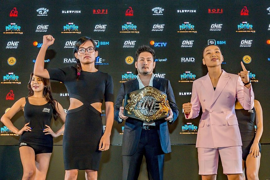 Singapore's Tiffany Teo (in black dress) is putting her unbeaten professional record on the line tomorrow night, when she fights China's Xiong Jingnan. With them is One Championship chairman and CEO Chatri Sityodtong.