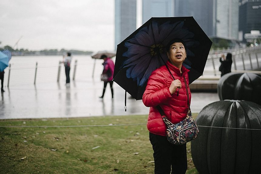 Last week's monsoon surge led to five days of cool but rainy weather, prompting some people to break out their winter wear.