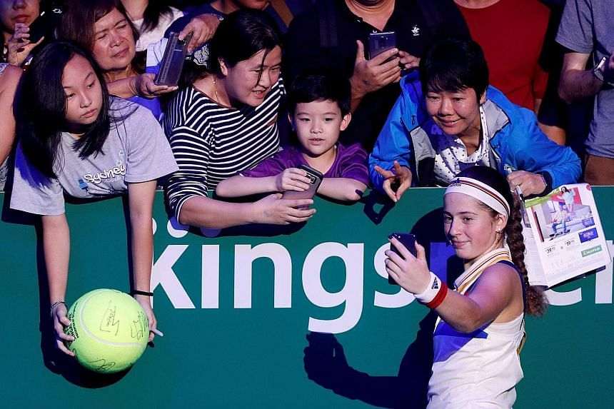 Latvia's Jelena Ostapenko with her fans after winning a match at the WTA Finals held at the Singapore Indoor Stadium in October last year. Shenzhen will host the event for the next 10 years after Singapore's contract as host ends this year.