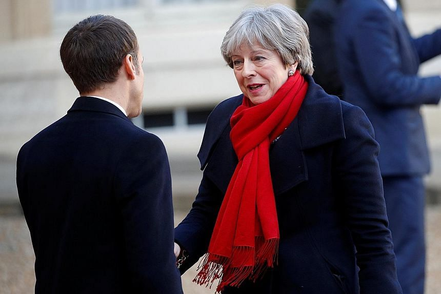 French President Emmanuel Macron with British PM Theresa May in Paris last December. At yesterday's talks in Sandhurst, Mrs May wanted to show that Britain still has plenty to offer France and the European Union.
