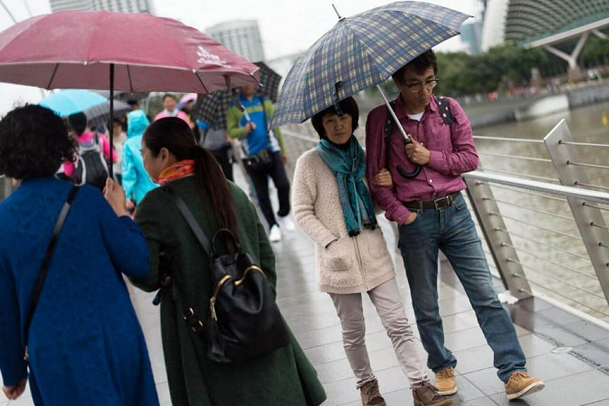 Temperatures in Singapore fell below 24 deg C for five days because of a monsoon surge.