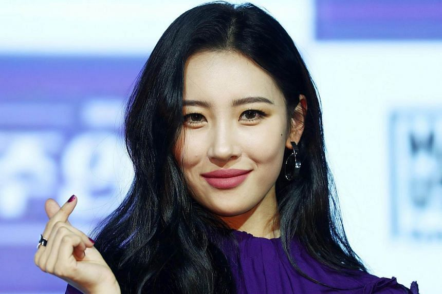 South Korean singer Sunmi poses for the camera during a showcase for her second single album Heroine in Seoul, on Jan 18, 2018.