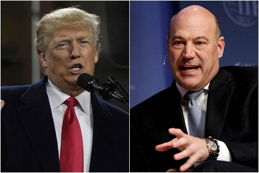 US President Donald Trump (left) and his economic adviser Gary Cohn said that China had forced US companies to transfer their intellectual property to the country as a cost of doing business there.