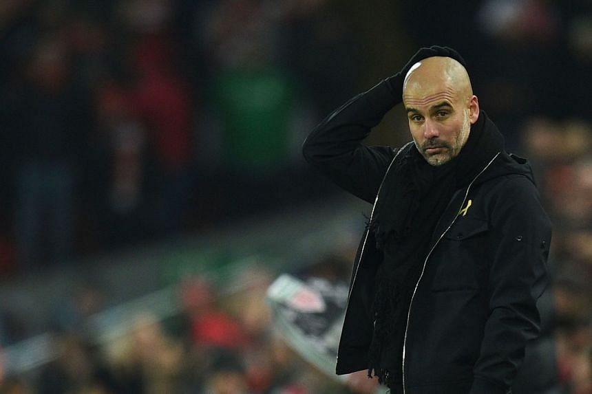 Guardiola reacts during a match against Liverpool on Jan 14, 2018.